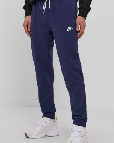 Spodnie bawełniane granatowe Nike Sportswear