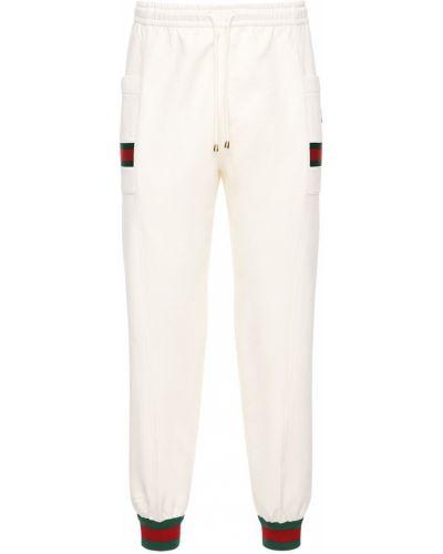 Хлопковые белые брюки на резинке Gucci
