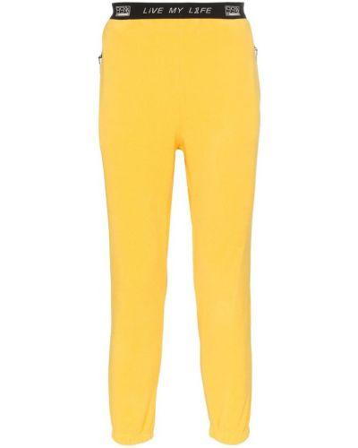 Желтые спортивные брюки с карманами 99% Is