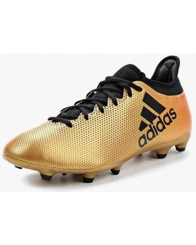 Бутсы золотого цвета Adidas
