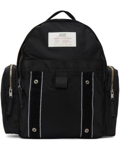Brezentowy czarny plecak na laptopa z kieszeniami Diesel