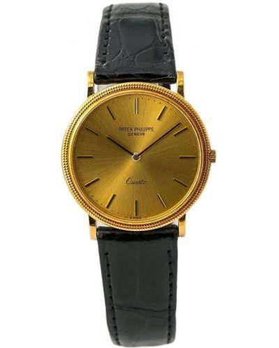 С ремешком часы золотые круглые Patek Philippe