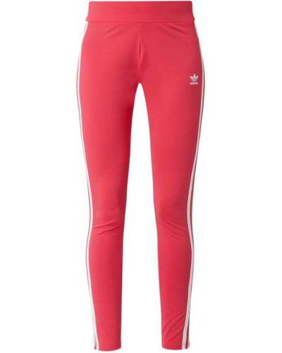 Różowe legginsy bawełniane Adidas