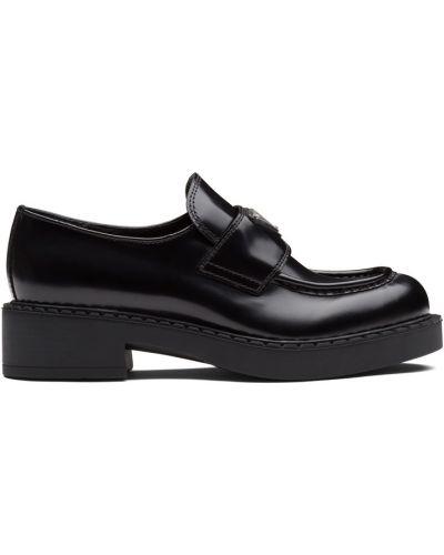 Черные кожаные лоферы Prada