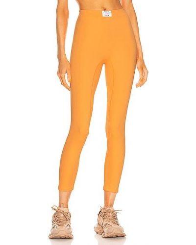 Pomarańczowe spodnie z nylonu Adam Selman Sport