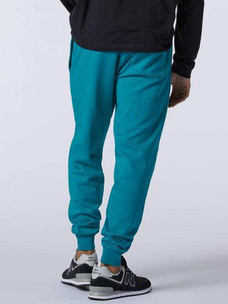 Бирюзовые хлопковые классические брюки с карманами New Balance