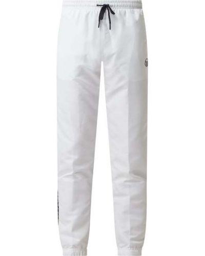 Białe spodnie z paskiem Sergio Tacchini