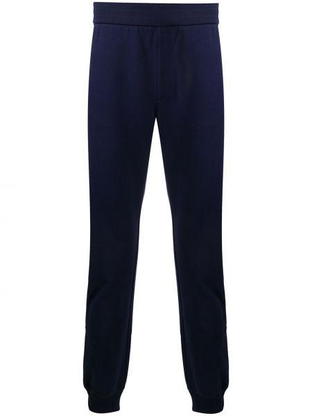 Синие брюки дудочки с карманами с манжетами Versace