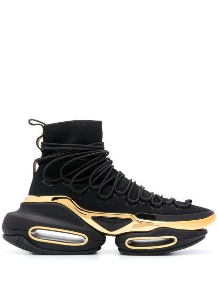 Złote czarne sneakersy na platformie Balmain