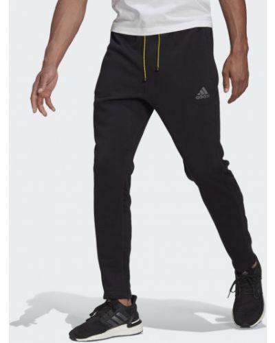 Мягкие зауженные черные брюки Adidas