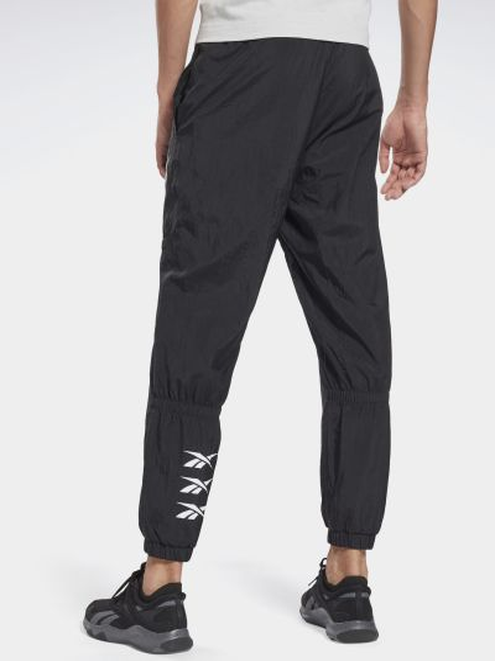Нейлоновые черные спортивные брюки с карманами Reebok