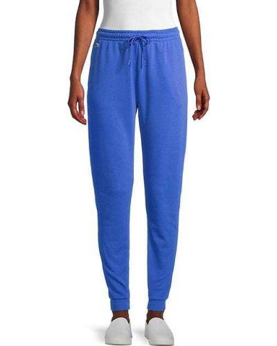 Хлопковые брюки с карманами с манжетами Lacoste