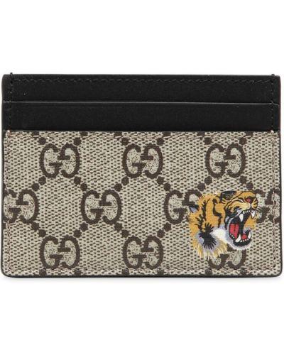 Бежевый кошелек с рисунком Gucci
