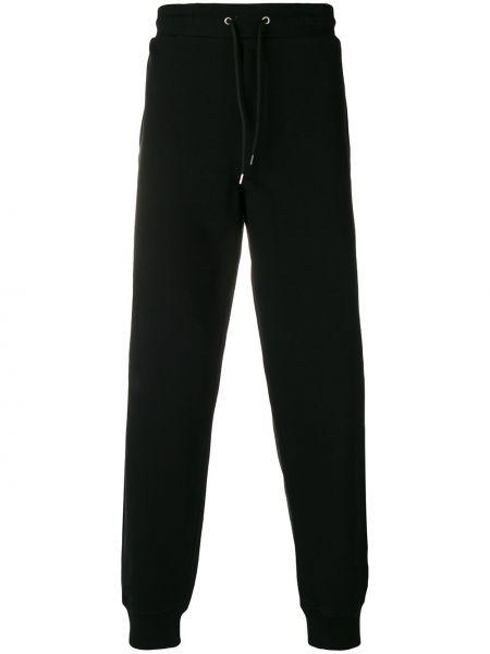 Czarne spodnie bawełniane z printem Mcq Alexander Mcqueen