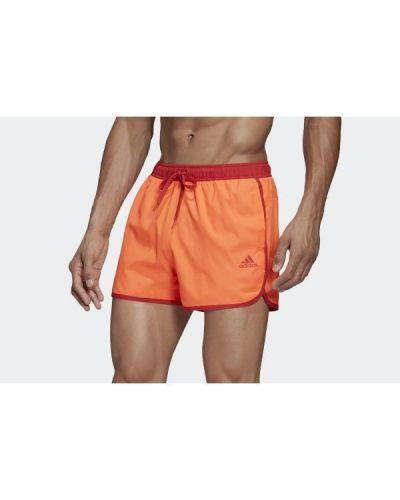 Pomarańczowe krótkie szorty Adidas