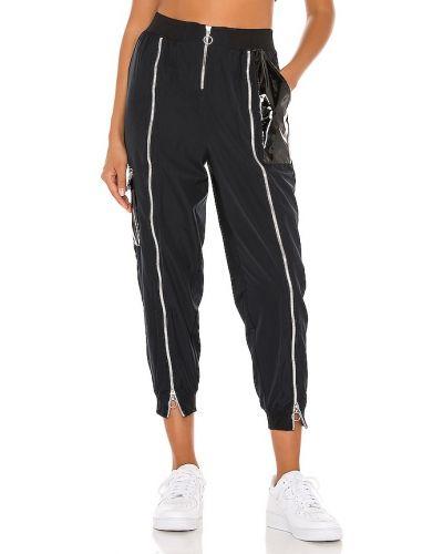 Czarny spodnie palazzo w połowie kolana z kieszeniami z zamkiem błyskawicznym Nike