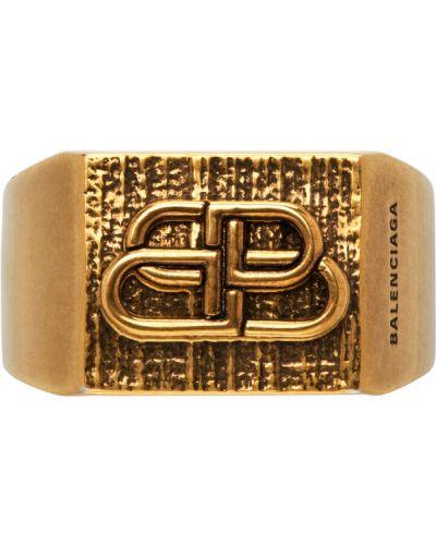 Złoty pierścionek Balenciaga