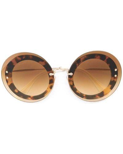 Солнцезащитные очки круглые коричневый Miu Miu Eyewear