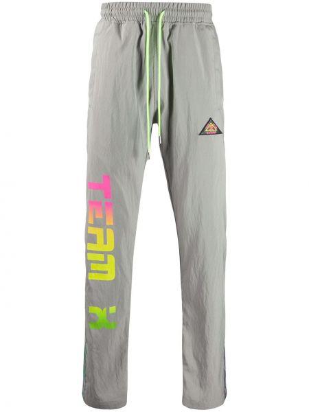 Spodnie skorzane w paski z printem Just Don