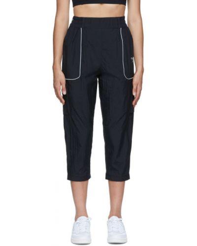 Нейлоновые черные брюки карго с карманами Reebok Classics