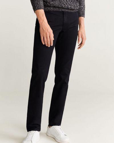 Spodnie chinos z kieszeniami wełniane Mango Man
