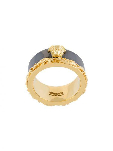 Золотистое кольцо золотое металлическое Versace