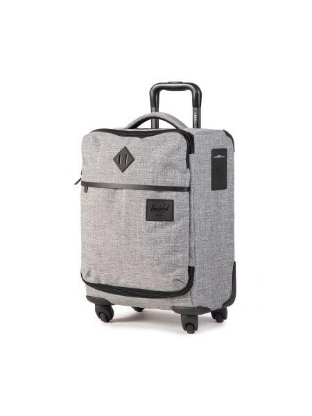 Szara walizka materiałowa Herschel