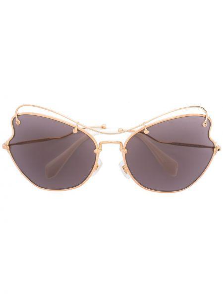 Желтые солнцезащитные очки металлические Miu Miu Eyewear