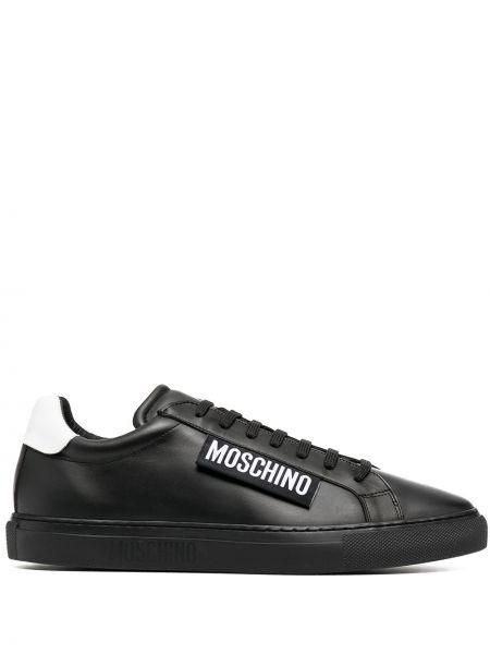 Skórzany czarny skórzane sneakersy z łatami na sznurowadłach Moschino