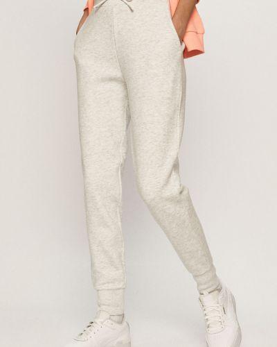 Białe spodnie bawełniane 4f
