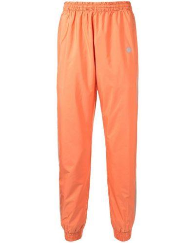 Оранжевые зауженные брюки с поясом с манжетами бязевые Astrid Andersen