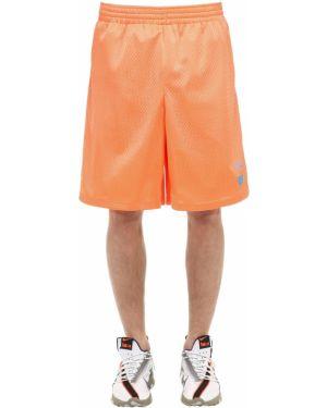 Pomarańczowe krótkie szorty z nylonu z siateczką Ufu - Used Future