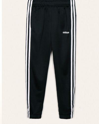 Spodnie z kieszeniami długo Adidas