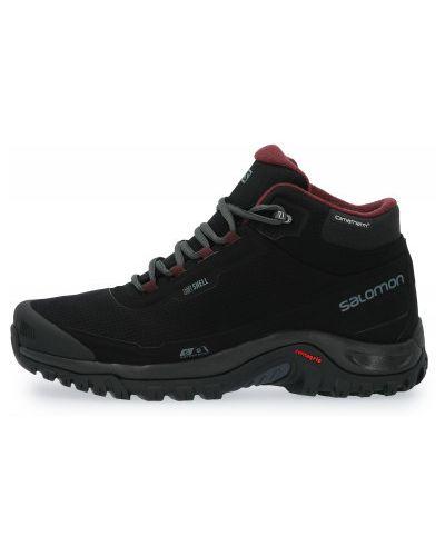 Черные кожаные сапоги на шнуровке Salomon