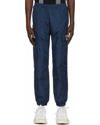 Białe spodnie z haftem z nylonu Misbhv