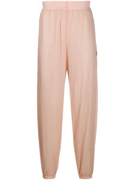 Różowe spodnie z nylonu z siateczką Gmbh