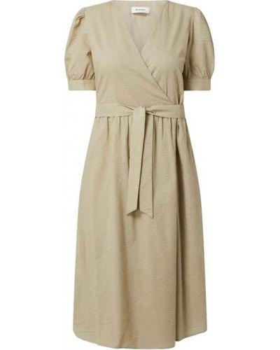 Sukienka rozkloszowana z wiązaniami - beżowa Modström