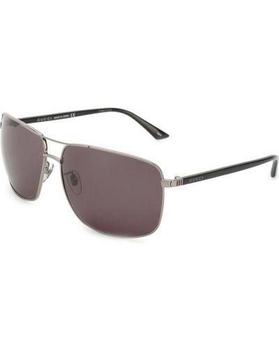 Серые солнцезащитные очки Gucci