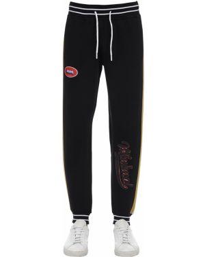 Czarne spodnie w paski z haftem Minimal