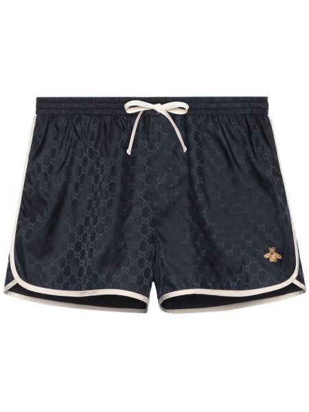 Niebieskie krótkie szorty z haftem z nylonu Gucci