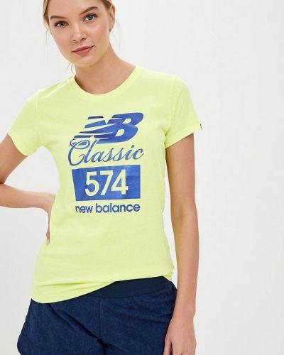 Желтое поло New Balance