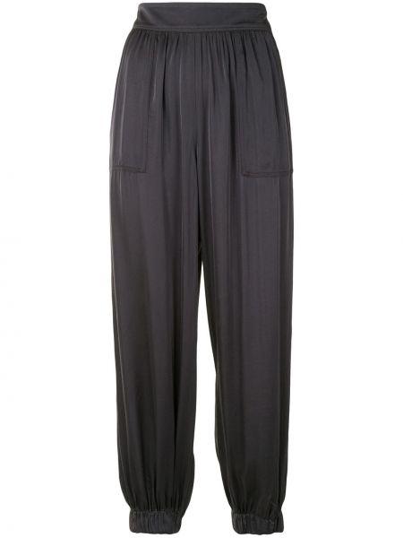 Зауженные свободные брюки с поясом свободного кроя из вискозы Raquel Allegra
