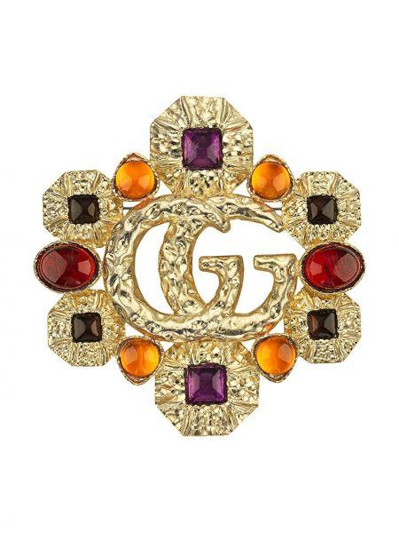 Złota broszka pozłacana Gucci