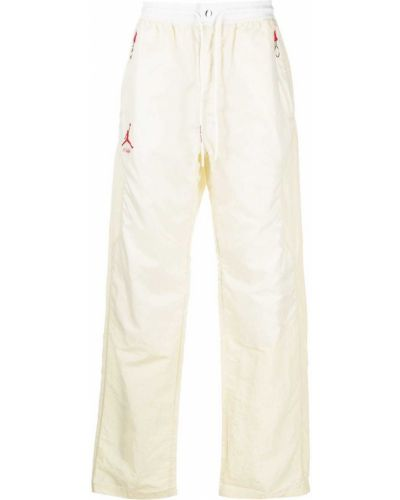 Białe spodnie z nylonu z printem Nike X Off White
