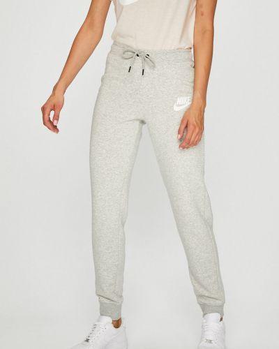 Спортивные брюки на резинке серые Nike Sportswear