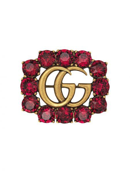 Złota broszka pozłacana miejska Gucci