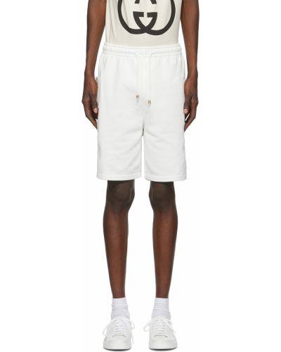 Белые шорты с нашивками Gucci