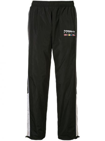 Czarne spodnie z haftem z wiskozy Misbhv