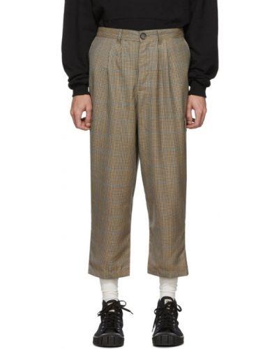 Beżowe spodnie wełniane z paskiem Landlord