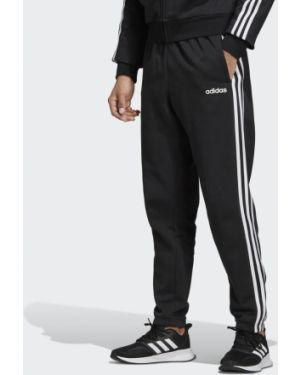 Флисовые черные спортивные брюки с нашивками Adidas